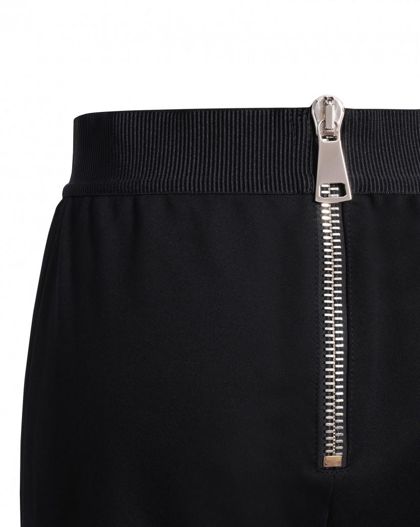 Czarne elastyczne i dopasowane spodnie z ozdobnym zamkiem