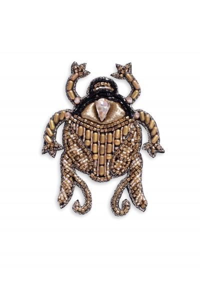 Biżuteryjna broszka w kształcie owada