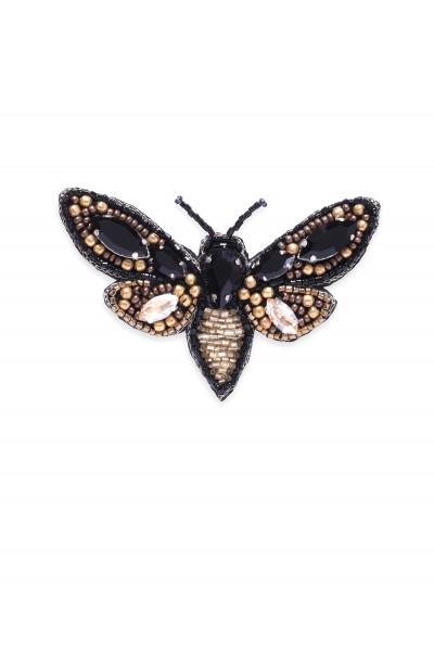 Biżuteryjna czarna broszka ze złotymi akcentami