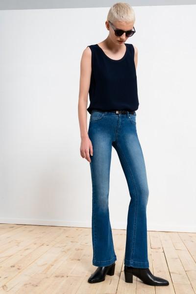 Jasne jeansowe dzwony z elastanem lekko wytarte
