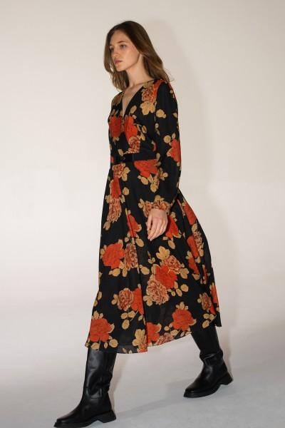 Rozkloszowana sukienka w kwiatowy wzór z kopertową górą